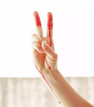 peace showing hand with period blood